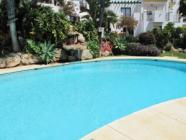 ground floor apartment in Alhaurín Golf with private garden leading to swimming pool